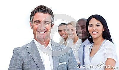 Confident mature businessman with his team