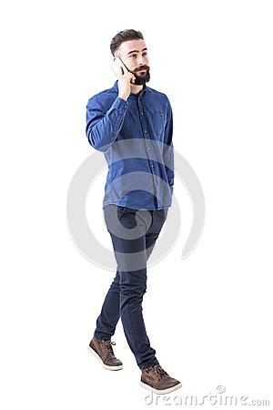 Free Confident Relaxed Young Adult Male Business Manager Walking And Talking On The Mobile Phone. Royalty Free Stock Photo - 113784445