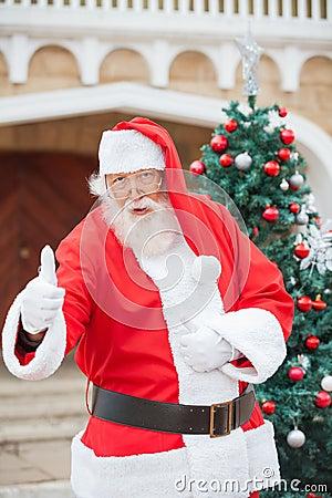 Confident Santa Claus Gesturing Thumbsup