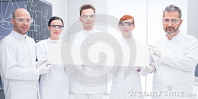 Confident scientists in lab