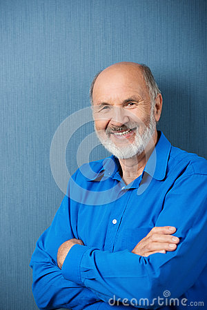 Confident senior man with folded arms