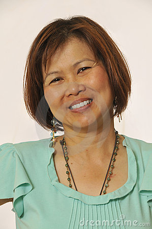Confident and smiling Asian woman