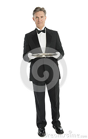 Confident Waiter With Serving Tray Standing Against White Backgr