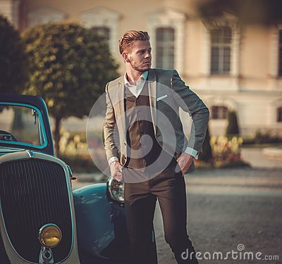 Free Confident Wealthy Man Near Classic Convertible Royalty Free Stock Images - 72187619