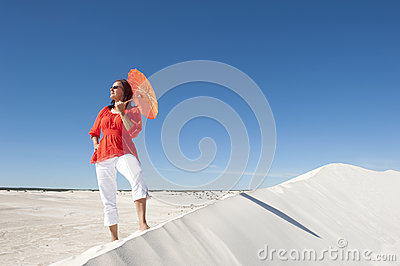Confident woman on desert sand dune