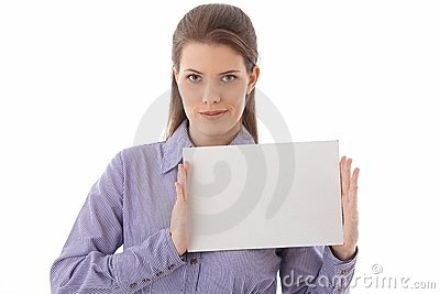 Confident woman holding blank sheet in studio