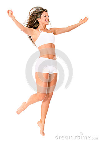 Confident woman jumping
