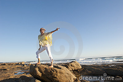 Confident woman pointing to forward direction