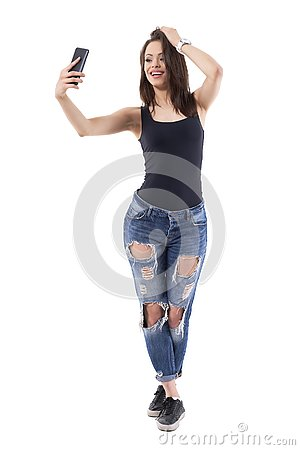 Free Confident Woman With Hand In Hair Taking Selfie Photos For Photo Messaging With Boyfriend. Royalty Free Stock Image - 131882756