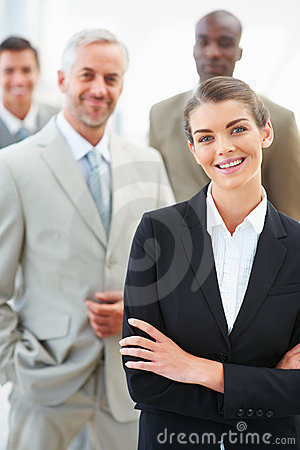 Confident young business woman with colleagues
