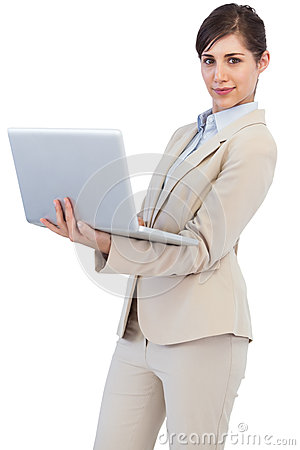 Confident young businesswoman with laptop