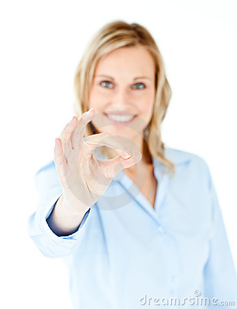 Confident young businesswoman showing OK sign