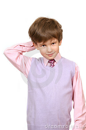 The confuse boy in a pink shirt