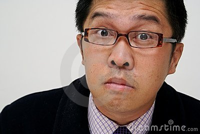 Confused asian businessman