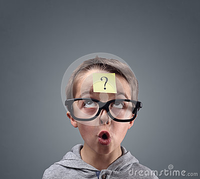 Free Confused Boy Thinking With Question Mark Royalty Free Stock Photo - 94227675