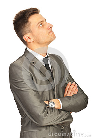 Confused business man looking up