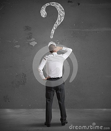 Free Confused Businessman Looking At Question Mark Royalty Free Stock Photos - 28933188