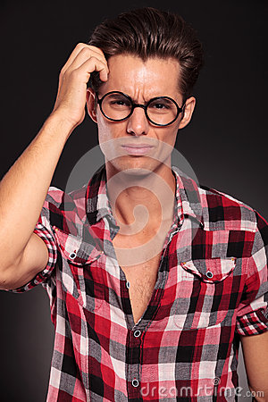 Confused casual man with glasses