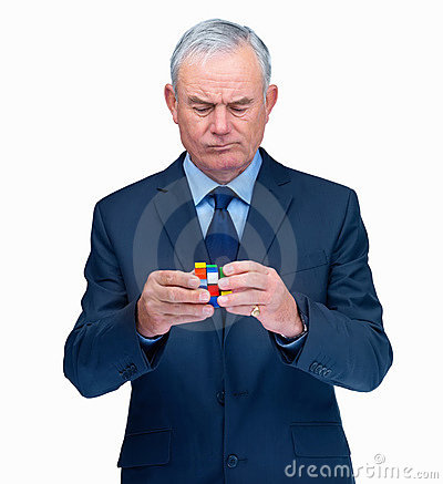 Confused elderly business man with a  cube Editorial Photo