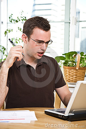 Confused man paying bills