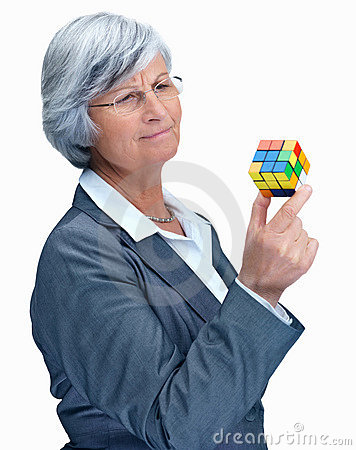 Confused mature business woman holding a  cube Editorial Image