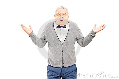 Confused senior man gesturing with hands isolated on white backg