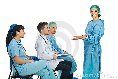 Confused surgeon woman at seminar
