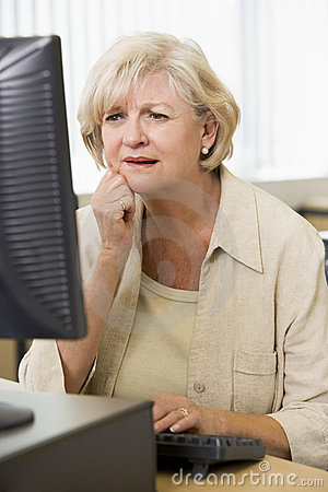Confused woman frowning at computer