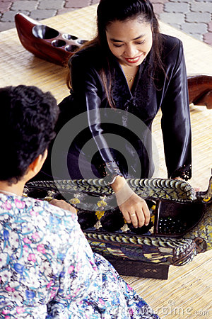 Congkak or Congklak Editorial Stock Photo