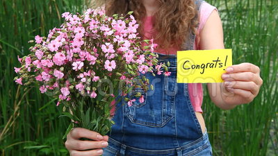 Congrats - beautiful woman with card and flowers. Beautiful woman with Congrats word and bouquet of pink flowers