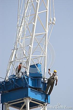 Constrction worker on crane