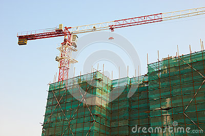 Construction of the building with a crane