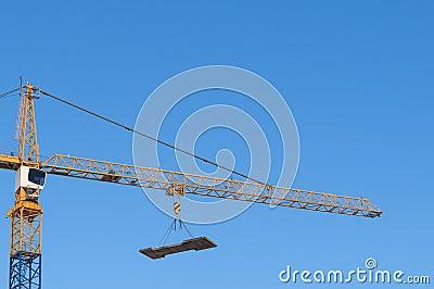 Construction crane hanging load