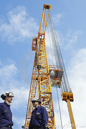 Construction crane with workers