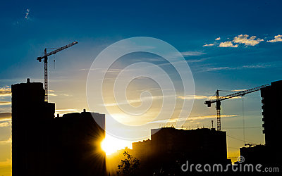 Construction cranes and building silhouettes