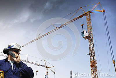 Construction cranes and building worker