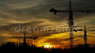 Construction cranes timelapse. Construction cranes fading from dusk into the night