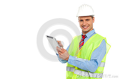 Construction engineer operating wireless device