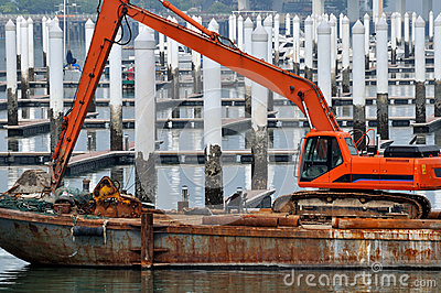 Construction equipment working at dock