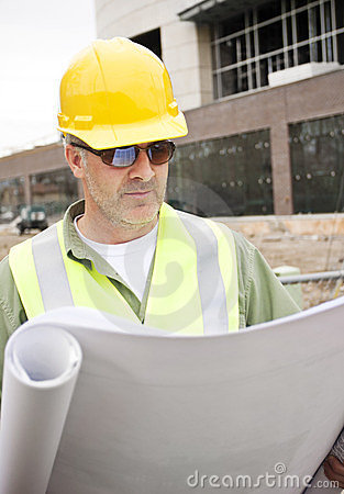 Construction Foreman looking at Blueprints