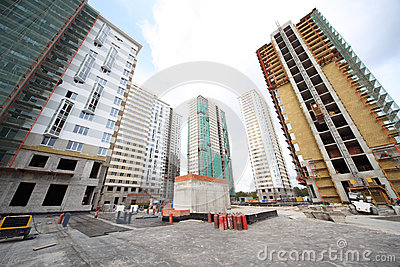 Construction of high buildings with workers Editorial Image