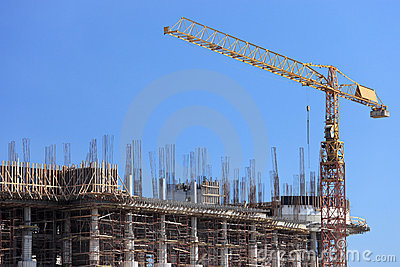 Construction site with crane over a building