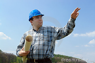 Construction site manager with building plans