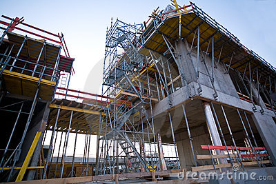 Construction site with scaffolder