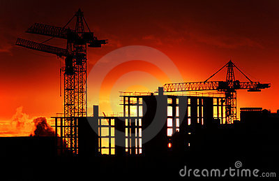 Construction site at orange sunset