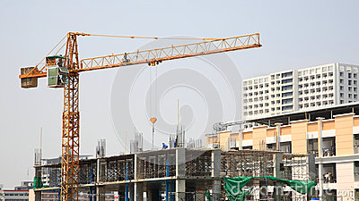 Construction site with yellow crane and workers Editorial Photo