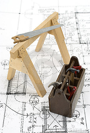 Construction tools on house plans.