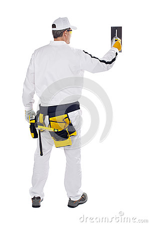 Construction worker in back with trowel wall