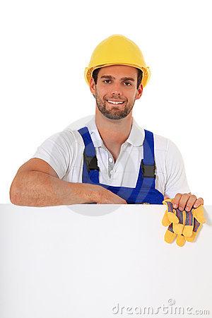 Construction worker behind blank white sign