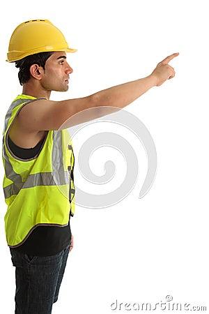 Construction worker or builder pointing finger